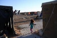 農業で生計を立てる人たちが暮らすテント村。ヨルダンには同様のテント村が約400カ所あり、1万6000人が暮らす=ヨルダン・アンマンで2016年10月5日、久保玲撮影