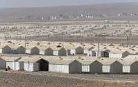 Jordan's Azraq refugee camp, surrounded by arid landscape, is seen in October 2016. (Mainichi)