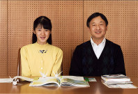 Crown Prince Naruhito and his daughter Princess Aiko smile for a picture taken on Nov. 23, 2016, at their residence in Tokyo's Minato Ward. (Courtesy of the Imperial Household Agency)