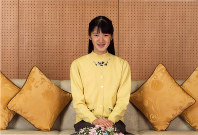 Princess Aiko smiles for a photo taken on Nov. 23, 2016, at her residence in Tokyo's Minato Ward. (Courtesy of the Imperial Household Agency)