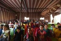 ユニセフがNGOなどと協力して運営するサポートスクールで勉強する子どもたち。ヨルダンで暮らすシリア難民で学齢期の22万6000人のうち、8万人以上が公的な教育を受けていない=ヨルダン・アンマンで2016年10月5日、久保玲撮影