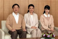 Crown Princess Masako, center, is pictured with Crown Prince Naruhito and their daughter Princess Aiko in this photo taken at Togu Palace on the occasion of the Crown Princess's 53rd birthday. (Photo courtesy of the Imperial Household Agency)