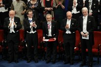 Yoshinori Ohsumi, center, honorary professor at Tokyo Institute of Technology, is applauded after receiving a medal commemorating his Nobel Prize in physiology or medicine at the Nobel Prize ceremony in Stockholm on Dec. 10, 2016. (Pool photo)