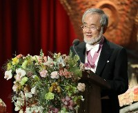 Yoshinori Ohsumi, honorary professor at Tokyo Institute of Technology, gives a speech after being awarded the 2016 Nobel Prize in physiology or medicine in Stockholm on Dec. 10, 2016. (Pool photo)