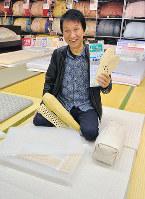 寝具製造・販売「ワタセ」の辻貴史さん=滋賀県近江八幡市安土町で、田中将隆撮影