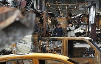 People gaze at the aftermath of a fire that burned down a neighborhood in Itoigawa, Niigata Prefecture, on Dec. 25, 2016. (Mainichi)