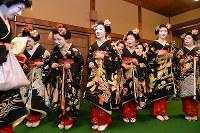 Apprentice geisha greet a senior geisha, left, ahead of a ceremony marking the New Year in Kyoto's Higashiyama Ward on Jan. 7, 2017. (Mainichi)