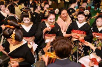 Geisha and apprentice geisha are treated to sake after a ceremony marking the New Year, in Kyoto's Higashiyama Ward on Jan. 7, 2017. (Mainichi)