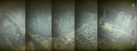 東京電力福島第1原発2号機の格納容器内で見つかった穴(大きさ1㍍四方)。溶融燃料の熱で、金属製の足場が脱落したとみられる=東京電力提供