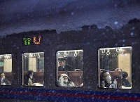 Passengers on a train stopped at Aoya Station in Tottori due to heavy snow wait for the train service on the JR Sanin Line to resume early on the morning of Feb. 11, 2017. (Mainichi)