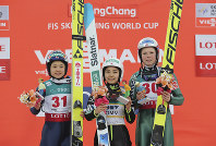First place winner Sara Takanashi of Japan, center, second placed Yuki Ito, left, also of Japan, and third placed Maren Lundby of Norway pose for photographers during the awards ceremony for the Ladies Normal Hill Individual event of the FIS Ski Jumping World Cup in Pyeongchang, South Korea, on Feb. 16, 2017. (AP Photo/Lee Jin-man)
