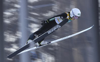 Japan's Sara Takanashi soars through the air during the first round of the Ladies Normal Hill Individual competition of the FIS Ski Jumping World Cup in Pyeongchang, South Korea, on Feb. 16, 2017. (AP Photo/Lee Jin-man)