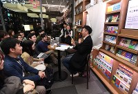Fans attend a talk show shortly before the unveiling of Haruki Murakami's new book