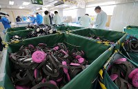 Piles of protective masks are seen here inside TEPCO's Fukushima No. 1 Nuclear Power Plant in the town of Okuma, Fukushima Prefecture, on Feb. 24, 2017. (Mainichi)