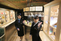 A service counter and showcases are seen inside JR Kyushu's new sightseeing train