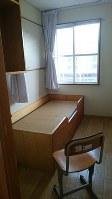面談に使う寮の個室。ユウカさんは教官に、過去に遭った性被害のことを初めて打ち明けた=榛東村で