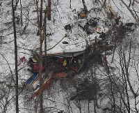 A Nagano Prefectural Government rescue helicopter is seen crashed in a mountainous area in Nagano Prefecture on March 5, 2017. (Mainichi)