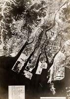 米軍が被爆前に撮影した航空写真。軍事施設や軍需工場、橋などに番号が付されている=原爆資料館提供