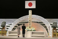 Japanese Prince Akishino, right, accompanied by Princess Kiko, delivers a speech in front of an altar for the victims of the March 11, 2011 earthquake and tsunami at a national memorial service in Tokyo, on March 11, 2017. Japan marked the sixth anniversary of the 2011 disaster in which more than 18,000 people died or went missing. (AP Photo/Koji Sasahara, Pool)
