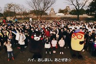 This still image taken from a YouTube video shows Kumamoto Prefecture's official mascot Kumamon and local residents taking part in the