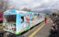 "Minami-aso Railway's ""Ganbare Kumamoto! Manga Yosegaki Train"" covered with popular characters leaves Takamori Station, in Takamori, Kumamoto Prefecture, on April 15, 2017. (Mainichi)"