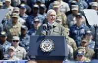 U.S. Vice President Mike Pence delivers a speech on the flight deck of the U.S. Navy's nuclear-powered aircraft carrier USS Ronald Reagan, at the U.S. Navy's Yokosuka base in Yokosuka, Kanagawa Prefecture, on April 19, 2017. (Mainichi)