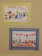 マスキングテープを額縁のように張り付けた絵=東京都練馬区の工房で、山崎明子撮影
