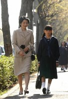 Princess Kiko and Princess Mako head to an entrance ceremony at Gakushuin Girls' Junior High School on April 6, 2004. (Pool photo)