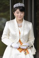 Princess Mako is seen in front of the Imperial Palace after greeting her grandparents Emperor Akihito and Empress Michiko on the occasion of her coming-of-age ceremony on Oct. 23, 2011. (Pool photo)