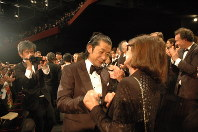 Actor Masatoshi Nagase, center, is seen amid applause following an official screening of the film