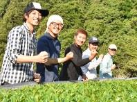 Yoshiyuki Tamura, far left, and the other members of