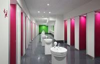 等々力陸上競技場の女子トイレ。個室の扉が開くと内側の赤色が見え、空室のサインとなる=川崎市提供