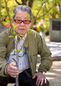 Keisaburo Toyonaga touches one of the rose of Sharon trees planted beside the Korean hibakusha memorial at Hiroshima Peace Memorial Park, in Hiroshima's Chuo Ward, on April 28, 2017. (Mainichi)
