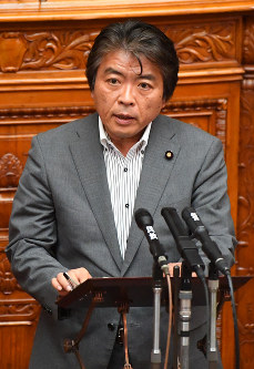Japanese Communist Party lawmaker Sohei Nihi asks a question about the