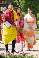 From left, Bhutan's King Jigme Khesar Namgyel Wangchuck, Queen Jetsun Pema and Japan's Princess Mako are seen at the Flower Exhibition in the Bhutan capital of Thimphu on June 4, 2017. (Pool photo)