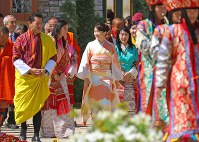 Princess Mako, center, visits the Flower Exhibition in the Bhutan capital of Thimphu with Bhutan's King Jigme Khesar Namgyel Wangchuck, left, and Queen Jetsun Pema, on June 4, 2017. (Pool photo)