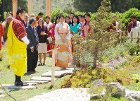 Princess Mako, center, visits the Japanese garden at the Flower Exhibition in the Bhutan capital of Thimphu, on June 4, 2017. (Pool photo)