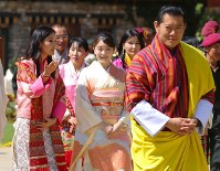 Princess Mako, center, visits the Flower Exhibition in the Bhutan capital of Thimphu with Bhutan's King Jigme Khesar Namgyel Wangchuck, front right, and Queen Jetsun Pema, left, on June 4, 2017. (Pool photo)