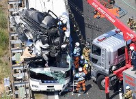 The scene of the accident where a car collided with a bus is pictured in Shinshiro, Aichi Prefecture, in this photograph taken from a Mainichi helicopter on June 10, 2017. (Mainichi)