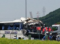 The severely damaged bus is seen after the accident in Shinshiro, Aichi Prefecture, on the morning of June 10, 2017. (Mainichi)