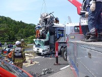 Firefighters and other workers separate the car and bus that collided in Shinshiro, Aichi Prefecture, on June 10, 2017. (Photo courtesy of Toshin Kanko Bus Co. Ltd.)