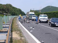 Vehicle parts are seen scattered on the road after the accident in Shinshiro, Aichi Prefecture, on June 10, 2017. (Photo courtesy of Toshin Kanko Bus Co. Ltd.)