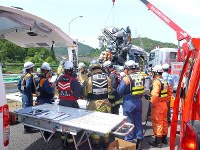 Rescue workers are pictured at the scene of the collision in Shinshiro, Aichi Prefecture, on June 10, 2017. (Photo courtesy of Toshin Kanko Bus Co. Ltd.)