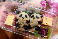 Rice balls made to look like pandas in celebration of the June 12 birth of a giant panda cub at Ueno Zoological Gardens are seen at the Taro delicatessen in the Matsuzakaya department store in Tokyo's Ueno district, on June 13, 2017. (Mainichi)