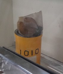 In this photo provided by the JAEA, the stainless steel radioactive material container involved in the June 6, 2017 accident is seen soon after the plastic bags inside burst, exposing five workers to powdered plutonium and uranium oxides, at the Oarai Research & Development Center in Oarai, Ibaraki Prefecture.