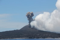 Nishinoshima violently erupts, ejecting volcanic ash and cinder from the volcano's crater. (Photo courtesy of the Meteorological Research Institute)