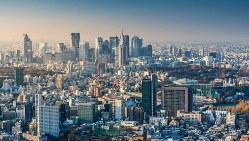 3年後の五輪を控え、東京の不動産価格見通しについていくつもの説が出ている