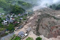 In this photo taken from a Mainichi Shimbun helicopter on July 6, 2017, a large landslide has swallowed houses in Hita, Oita Prefecture. (Mainichi)