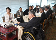 Japan Sports Agency Commissioner Daichi Suzuki, third from top left, and other Mainichi Universal Committee members attend a meeting in Tokyo's Chiyoda Ward on July 6, 2017. (Mainichi)