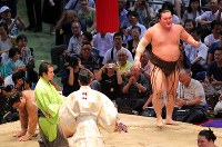 Yokozuna Hakuho looks triumphant after pushing opponent ozeki Takayasu to the ground in a bout at the Nagoya Grand Sumo Tournament on July 21, 2017. This marked Hakuho's 1,048th win, making him the lone record holder for most career wins. (Mainichi)